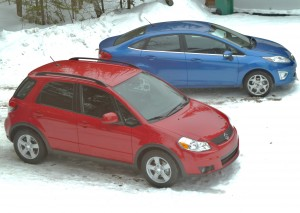 The all-wheel-drive Suzuki SX4 and front-wheel-drive Ford Fiesta both drive well in the winter, but can pose unusual chalenges in severe cold.