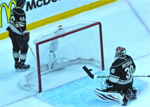 Wild goalie Ilya Bryzgalov could only look back at the puck, still in the goal, after Patrick Kane's overtime game-winner and season-ender.