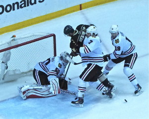 Brent Seabrook and Jonathan Toews couldn't prevent Wild rookie Nico Niederreiter from getting to goalie Corey Crawford.