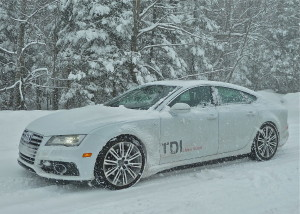 White Audi A7 TDI quattro needs graphics to be visible in snowstorm.