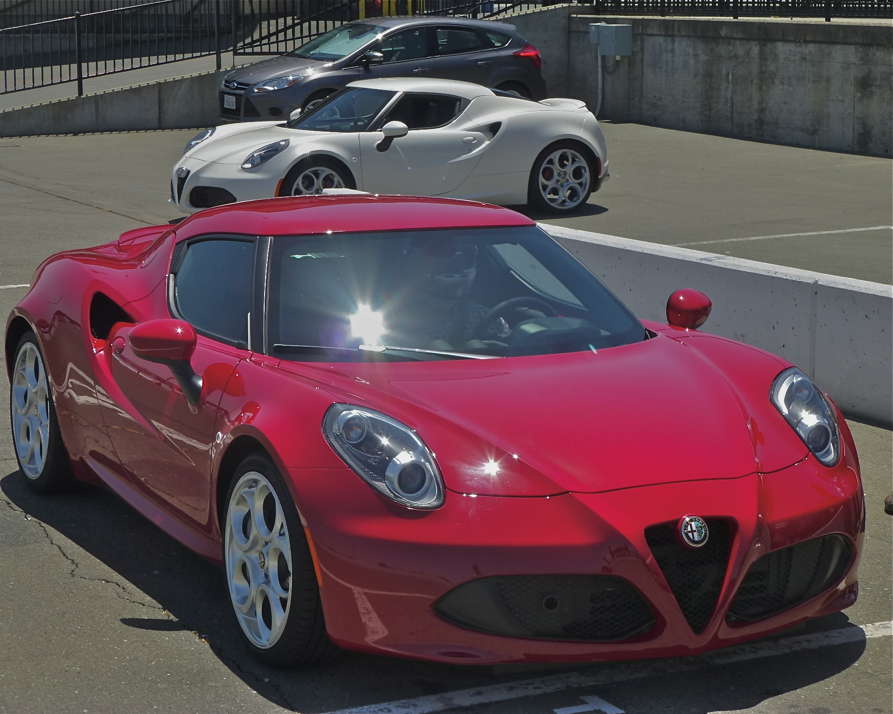 Light, carbon-fiber Alfa Romeo 4C gets exotic speed from 1,750 ccs.
