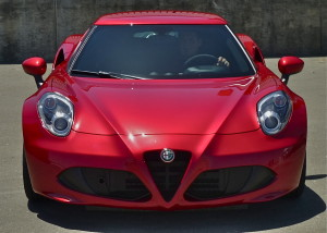 "All lines radiate from the 4C's familiar ""trilobo"" shield in the center of the low, sleek grille."