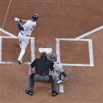 Derek Jeter's late swing sent a double down the right-field line.