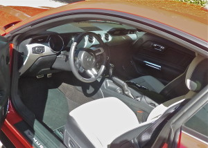 A choice of interiors are focused on driver's command, and the base seats are supportive, if a cut below the GT's Recaros.