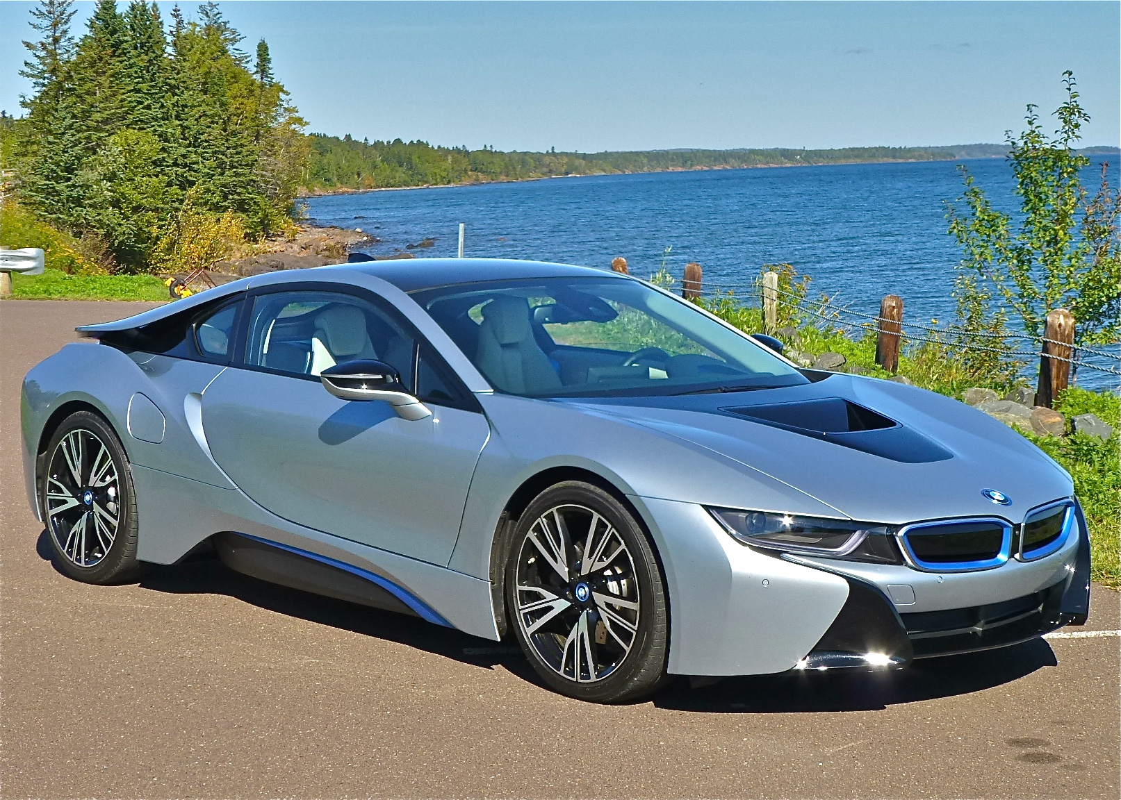 Low and sensual, the BMW i8 is a carbon-fiber exotic hybrid car with all-wheel drive.