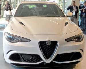 Familiar triangular Alfa center point on the grille links thoroughly modern Giulia with historic past.