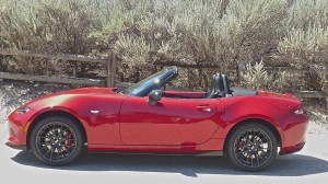 The smooth, sporty contours of the Miata make it look natural with the top down.