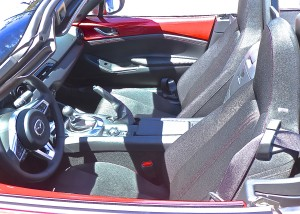 You fit into the two bucket seats as if wearing the Miata like a sports jacket.