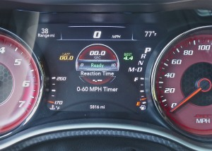 Gauge cluster shows elapsed time and reaction time.