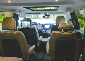 Modern and spacious view from the inside reveals sunroofs, video screens, bucket seats.