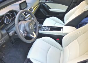 Luxurious leather covered the seats of the upscale 2017 Mazda3.