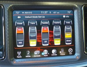Electronic switches allow selection of street, sport or track for driving preferences.