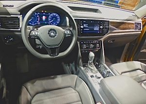 Driver's-eye view of the Atlas controls shows straightforward luxury and classy wood and leather everywhere.
