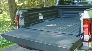 Folding tailgate down opens full expanse of scratchproof composite bed.