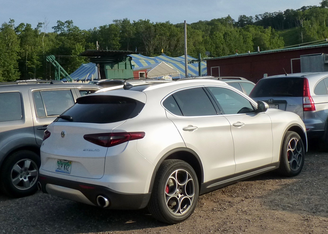 Alfa Romeo Stelvio Is Suv For S Curves New Car Picks Magnesium Wheels Ti Lusso Fit Easily Amid Normal Vehicles At The Big Top Chautauqua Parking Lot