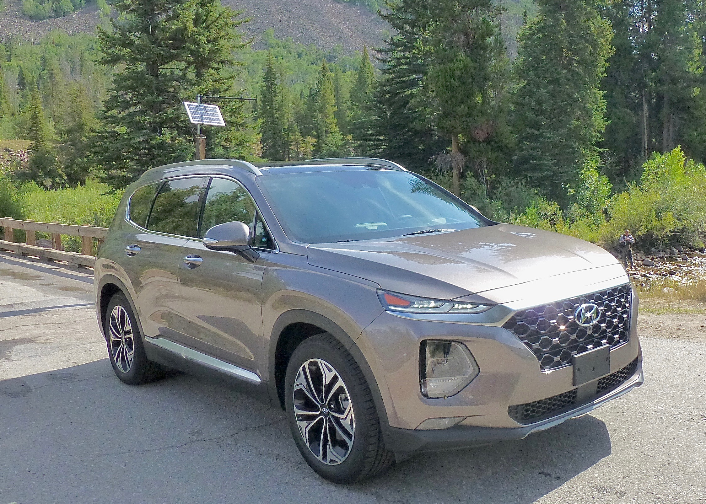 We paused in our test Santa Fe to observe a fly fisherman on a mountain stream.