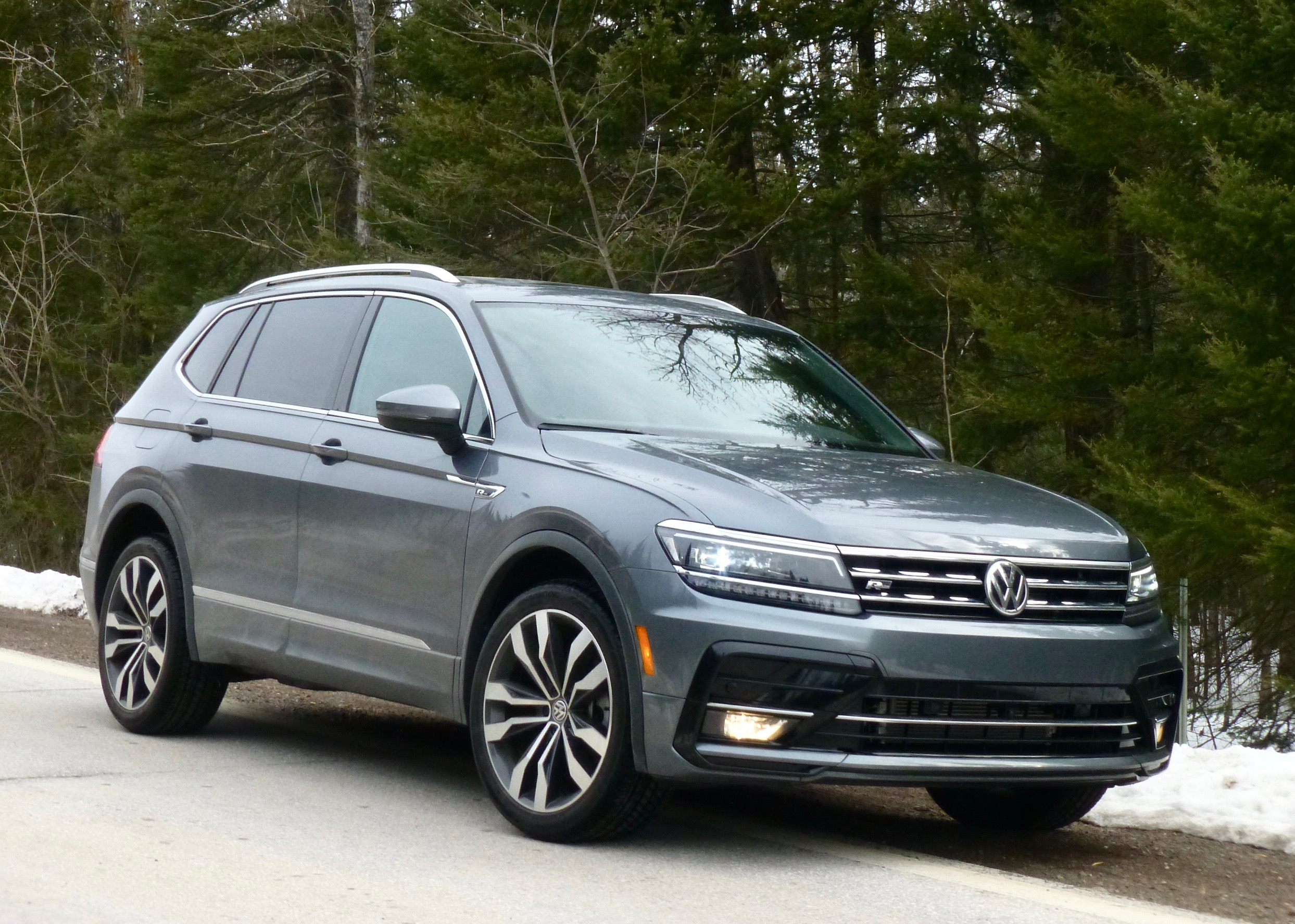 Longer Tiguan has optional third-row seat but retains style, solid feel for 2019.