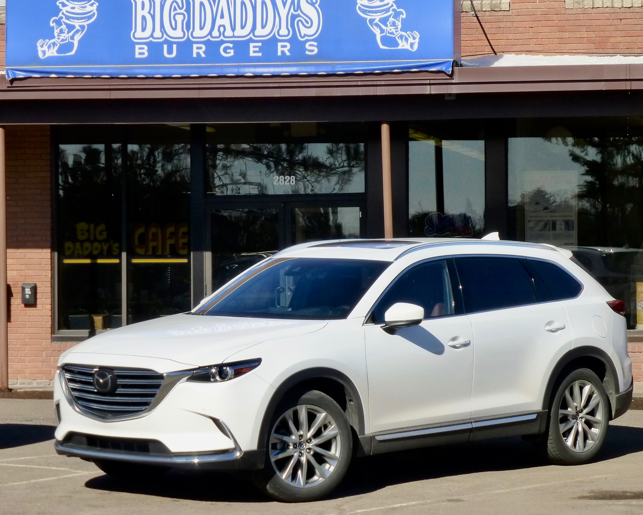 Sporty handling, roomy interior makes CX-9 perfect way to haul seven for burgers.